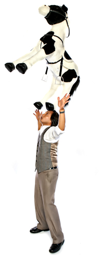David Kamatoy balances a large toy horse on his head.